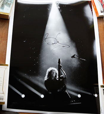 Signed print of Brian May auctioned for Cancer Research UK